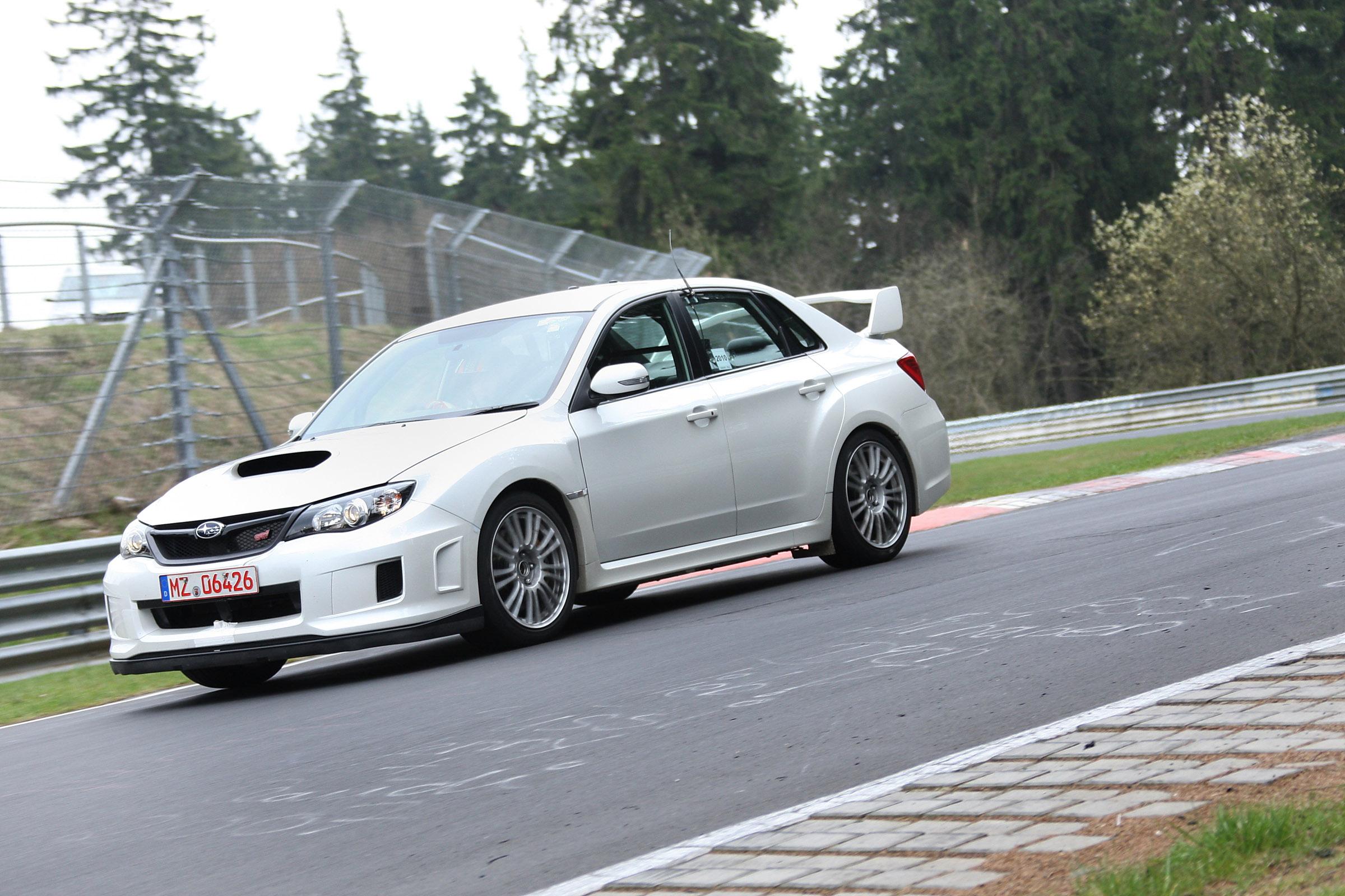 2011 Subaru WRX STi седан испытания на Нюрбургринге - фотография №12