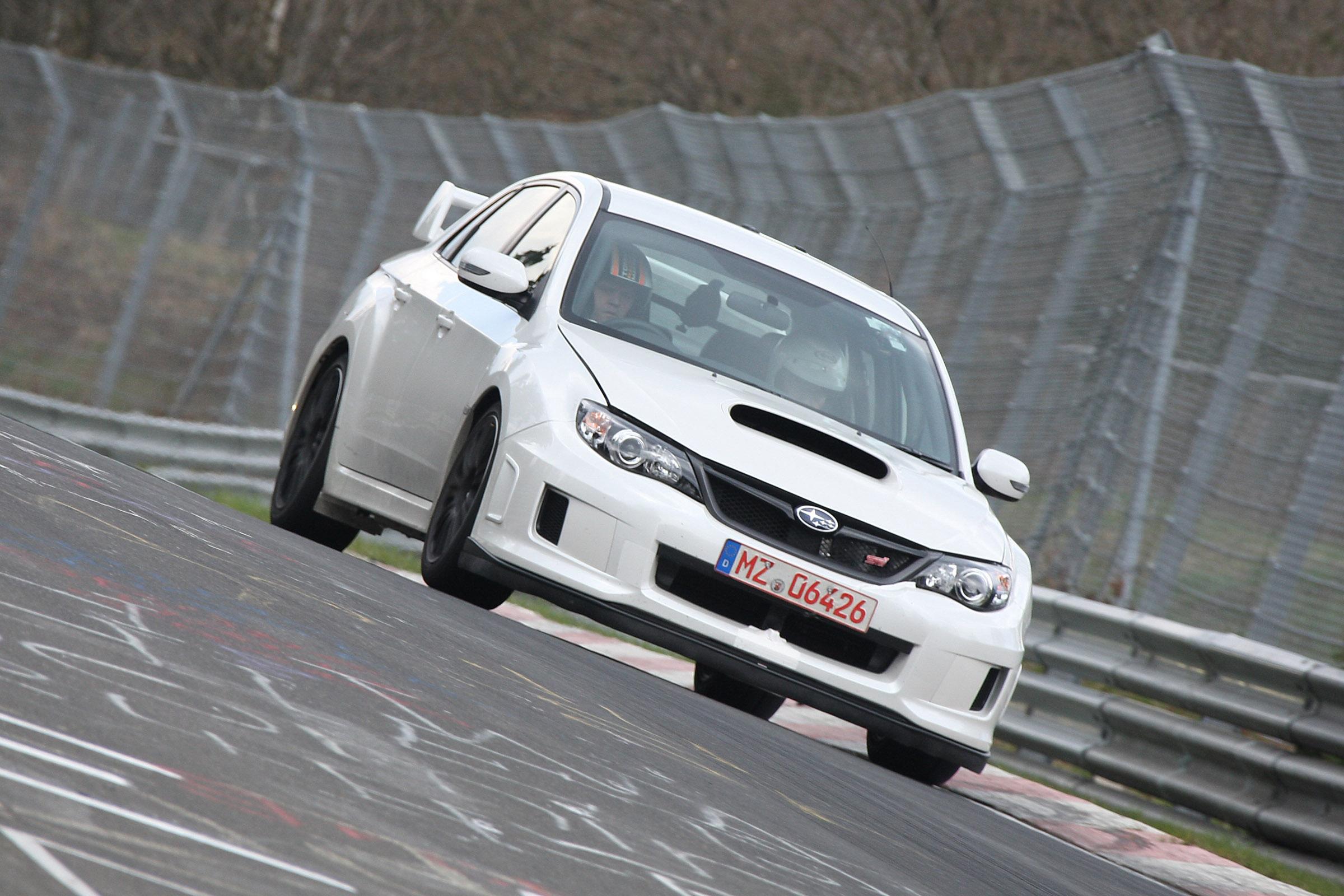 2011 Subaru WRX STi седан испытания на Нюрбургринге - фотография №16