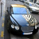 Bentley and Aston Martin with the Golden Roof