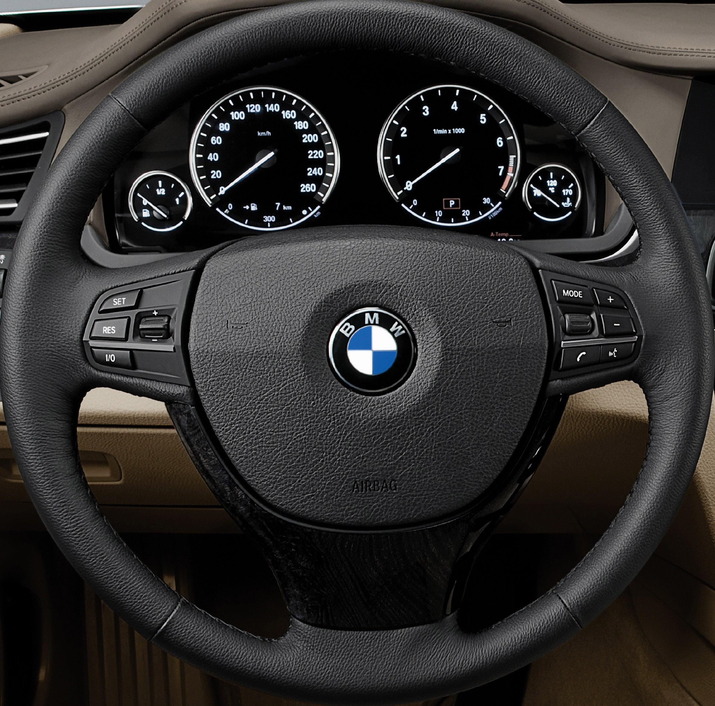 Пятое поколение BMW 7 серии влезает в крышку - фотография №43